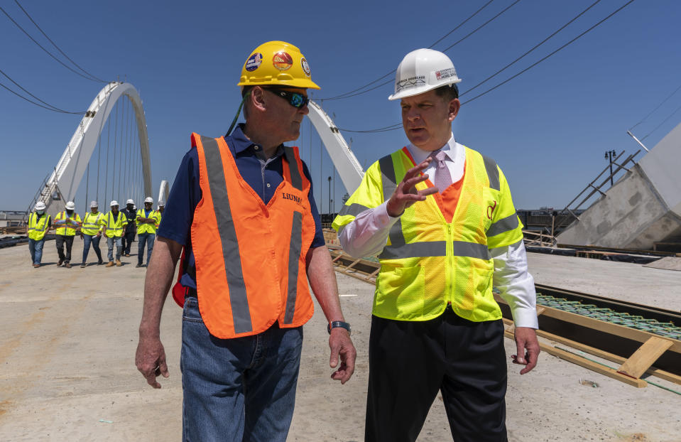 FILE - In this May 19, 2021, file photo Secretary of Labor Marty Walsh, right, visits the Frederick Douglass Memorial Bridge construction site together with District of Columbia Mayor Muriel Bowser and Secretary of Transportation Pete Buttigieg, in southeast Washington. (AP Photo/Manuel Balce Ceneta, FIle)