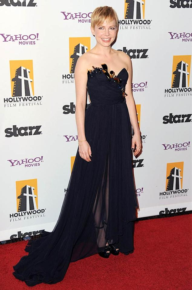 "Back at the Hollywood Film Awards, ""My Week With Marilyn"" star Michelle Williams dressed to impress in a midnight blue Nina Ricci gown, which featured cascading chiffon and a metal-adorned bustier. (10/24/11)"