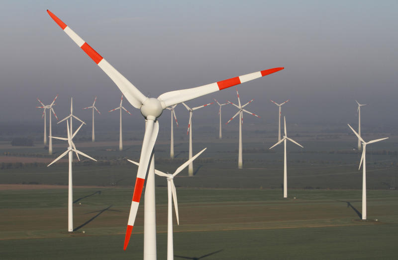 In this photo taken Oct. 12, 2012 wind turbines produce green energy in Nauen near Berlin, Germany. Germany's tax on households' electricity bills to finance the expansion of renewable energies will rise almost 50 percent on the year as the country pushes ahead with phasing out nuclear power within a decade. The country's four main grid operators say Monday Oct. 15, 2012 that the tax will rise from 3.6 euro cents to 5.3 euro cents (US $6.7 cents) per kilowatt hour starting in January. (AP Photo/Ferdinand Ostrop)