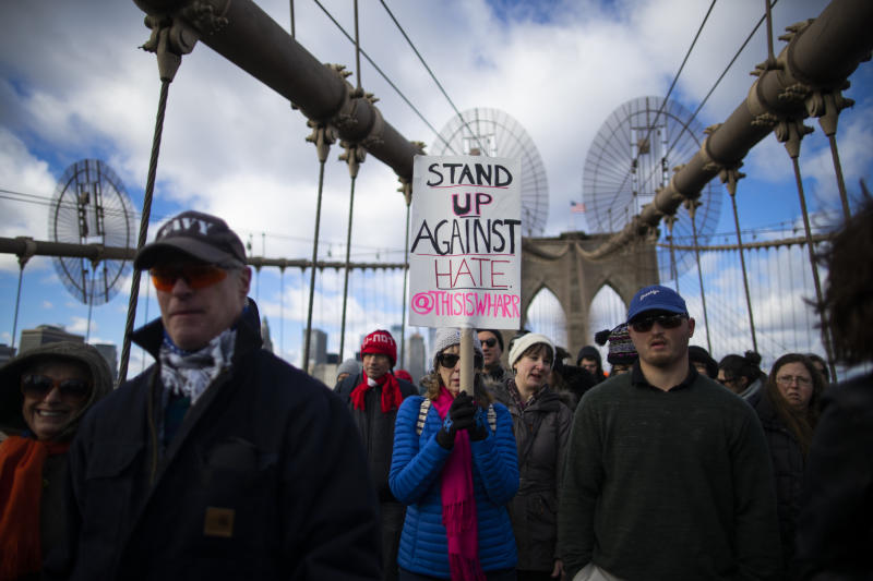 People take part in a march crossing the Brooklyn Bridge in solidarity with the Jewish community after recent string of anti-semitic attacks throughout the greater New York area, on Sunday, Jan. 5, 2020 in New York.  (AP Photo/Eduardo Munoz Alvarez)
