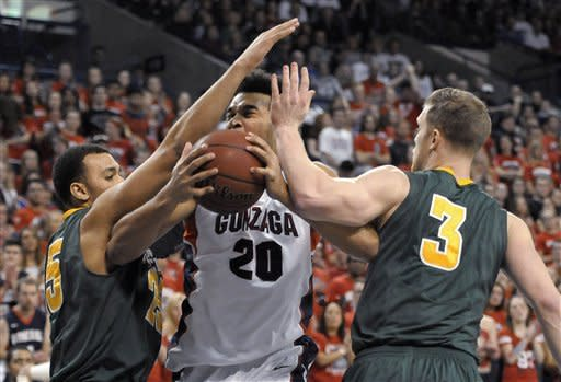 San Francisco's Cole Dickerson (25) and Matt Christiansen (3) defend Gonzaga's Elias Harris (20) during the first half of an NCAA college basketball game, Saturday, Jan. 26, 2013, in Spokane, Wash. (AP Photo/Jed Conklin)