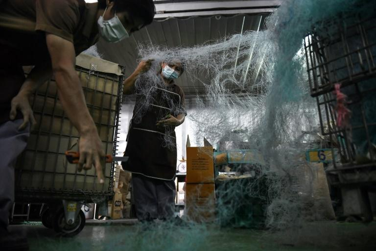 Collected nets are sent to be washed, shredded, mixed with other discarded plastics and melted into shape at Qualy Design