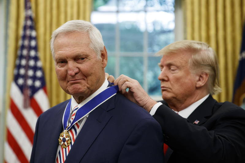 President Donald Trump, right, presents the Presidential Medal of Freedom to NBA legend Jerry West in the Oval Office of the White House on Thursday.