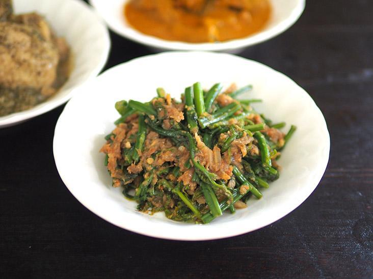'Pucuk paku belacan' is a fragrant combination of fern tops fried with fermented prawn paste.