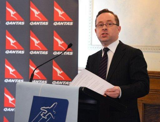 Qantas Airways CEO Alan Joyce announces the end of a lucrative marketing deal with Tourism Australia after claiming its boss was leading a consortium trying to unseat the airline's management and buy out the company, in Sydney on November 28, 2012