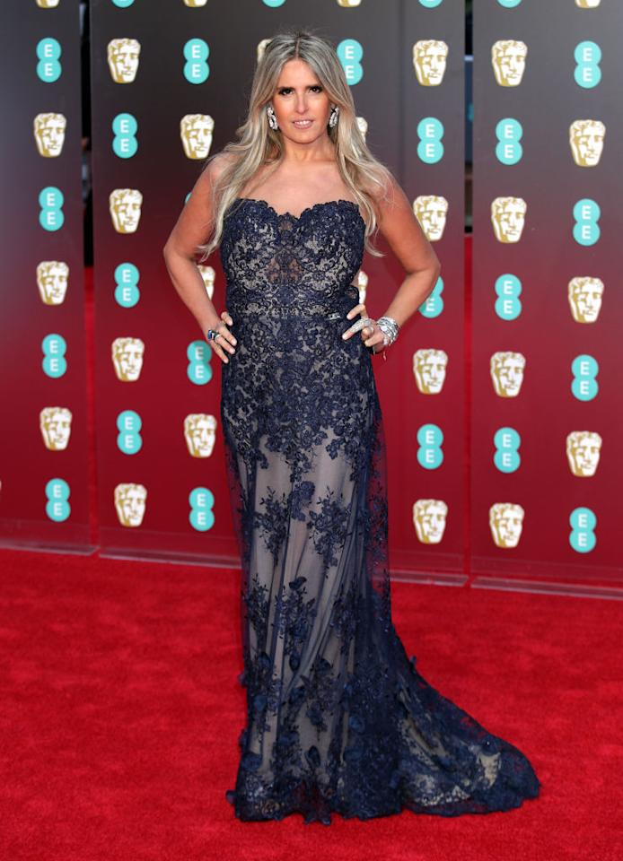<p>Actress Tiziana Rocca donned a strapless lace dress in cobalt blue for the BAFTA ceremony. <em>[Photo: Getty]</em> </p>