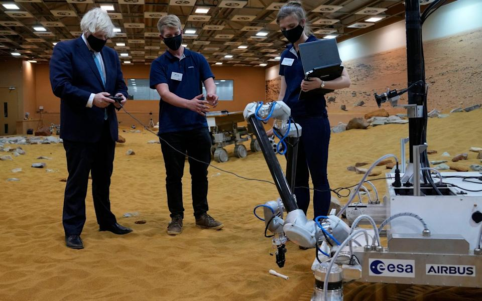 Life on Mars: Boris Johnson tries one of three prototype system testbed Mars Rovers at the Airbus Defence and Space plant in Stevenage - AP