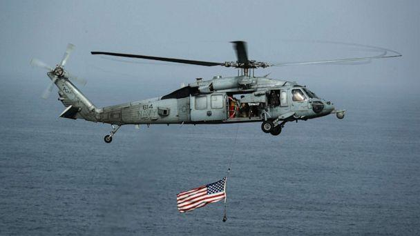 PHOTO: An MH-60S Sea Hawk helicopter flies over the Nimitz-class aircraft carrier USS Abraham Lincoln, July 4, 2019. (Mass Communication Specialist 3rd Class Jeff Sherman/U.S. Navy)