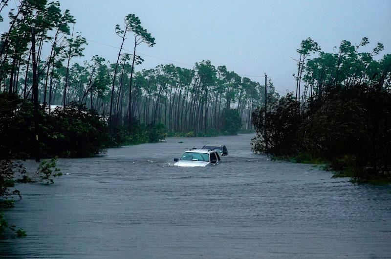 Cars are submerged in water in Freeport on Tuesday.