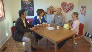 B.C. Liberal leader Christy Clark meets with a family in East Vancouver on Sunday.