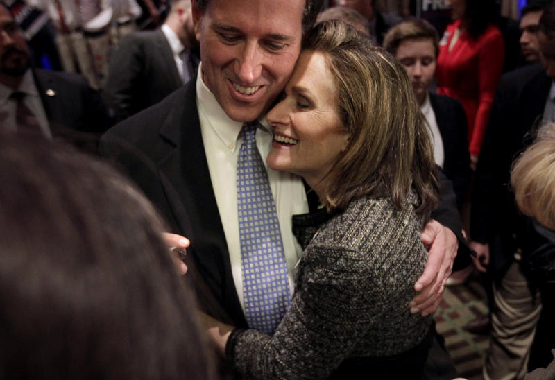 FILE - In this April 3, 2012 file photo, Republican presidential candidate, former Pennsylvania Sen. Rick Santorum gets a hug from his wife Karen in Cranberry, Pa. Santorum is suspending his campaign for the GOP presidential nomination, clearing a path for Mitt Romney to become the nominee. (AP Photo/Jae C. Hong, File)
