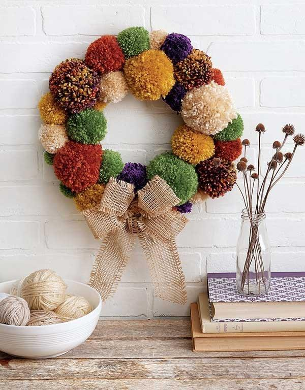 "<p>If you are a whiz with wool why not make yourself a pom pom wreath. <a rel=""nofollow"" href=""http://www.maggiescrochet.com/products/yarn-crafts""><em>[Photo: Maggies Crochet]</em></a> </p>"
