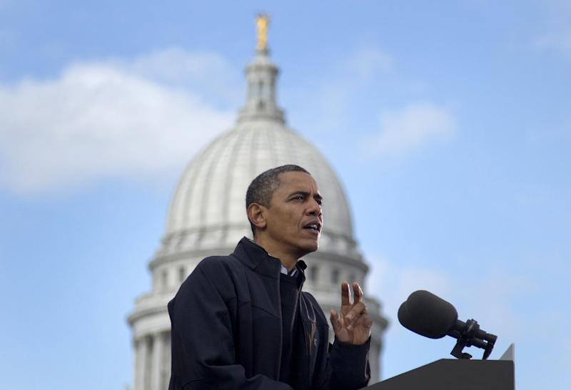 With the Wisconsin State Capitol building dome behind him, President Barack Obama speaks at a campaign event, Monday, Nov. 5, 2012, in downtown Madison, Wis.  (AP Photo/Carolyn Kaster)