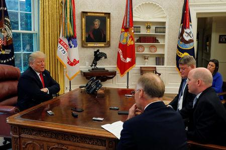 U.S. President Trump answers question during interview with Reuters reporters in Oval Office of White House in Washington
