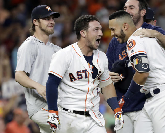 Alex Bregman's walk-off win gave the Astros their 12th straight win. (AP Photo)
