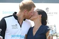 <p>Harry and Meghan kiss after posing with the trophy at the Sentebale Polo Cup 2018 held at the Royal County of Berkshire Polo Club.</p>