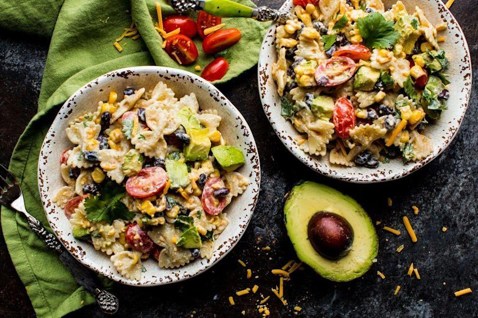 """<p>A great make-ahead option, this kicked-up pasta salad with zesty Greek yogurt dressing is full of flavor: taco seasoning, cilantro, cheddar cheese, avocado, black beans, and corn.</p><p><em><a href=""""https://www.delish.com/cooking/recipe-ideas/recipes/a53448/southwestern-pasta-salad-recipe/"""" rel=""""nofollow noopener"""" target=""""_blank"""" data-ylk=""""slk:Get the recipe from Delish »"""" class=""""link rapid-noclick-resp"""">Get the recipe from Delish »</a></em></p><p><strong>RELATED:</strong> <a href=""""https://www.goodhousekeeping.com/food-recipes/g27458162/bbq-salads/"""" rel=""""nofollow noopener"""" target=""""_blank"""" data-ylk=""""slk:34 BBQ Salads to Serve at Your Next Backyard Bash"""" class=""""link rapid-noclick-resp"""">34 BBQ Salads to Serve at Your Next Backyard Bash</a></p>"""