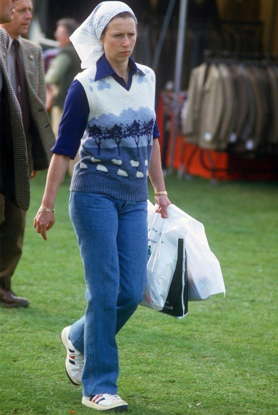 <p>Knitted vests are a key piece to invest in this season, and Princess Anne set the trend when she wore this blue outfit, finished off with simple gold jewellery and a white headscarf, in 1985.</p>