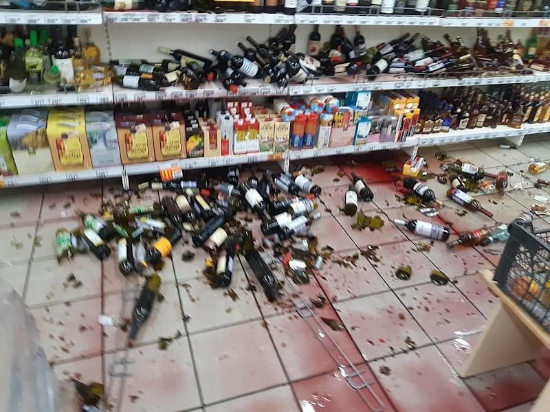 The dismissed worker solemnly congratulated the store owner after the rampage. Source: East2West/australscope