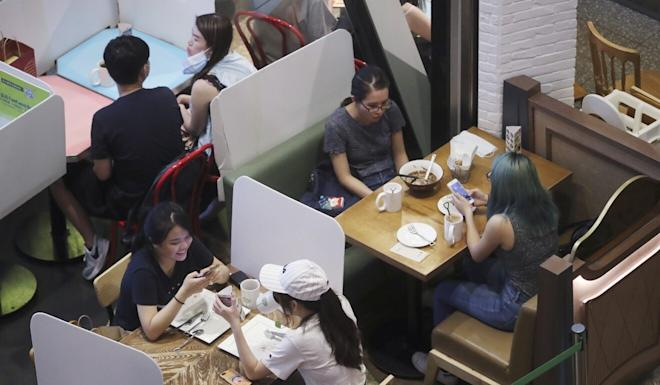 Plastic partitions separate diners at Moko mall in Mong Kok on a Sunday earlier in September. Photo: Edmond So