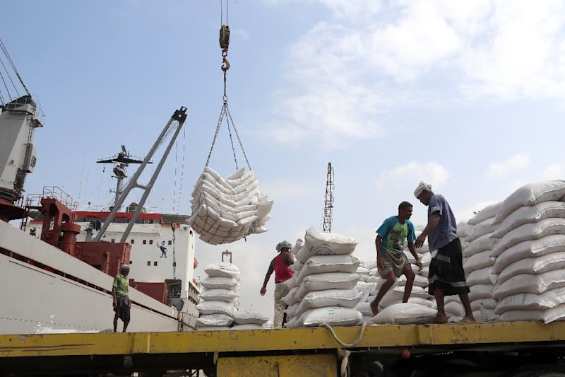 Workers unload UNICEF wheat donations in January from a cargo ship in the Red Sea port of Hodeida, a key entry point for UN aid to war-torn Yemen (AFP Photo/ABDO HYDER)