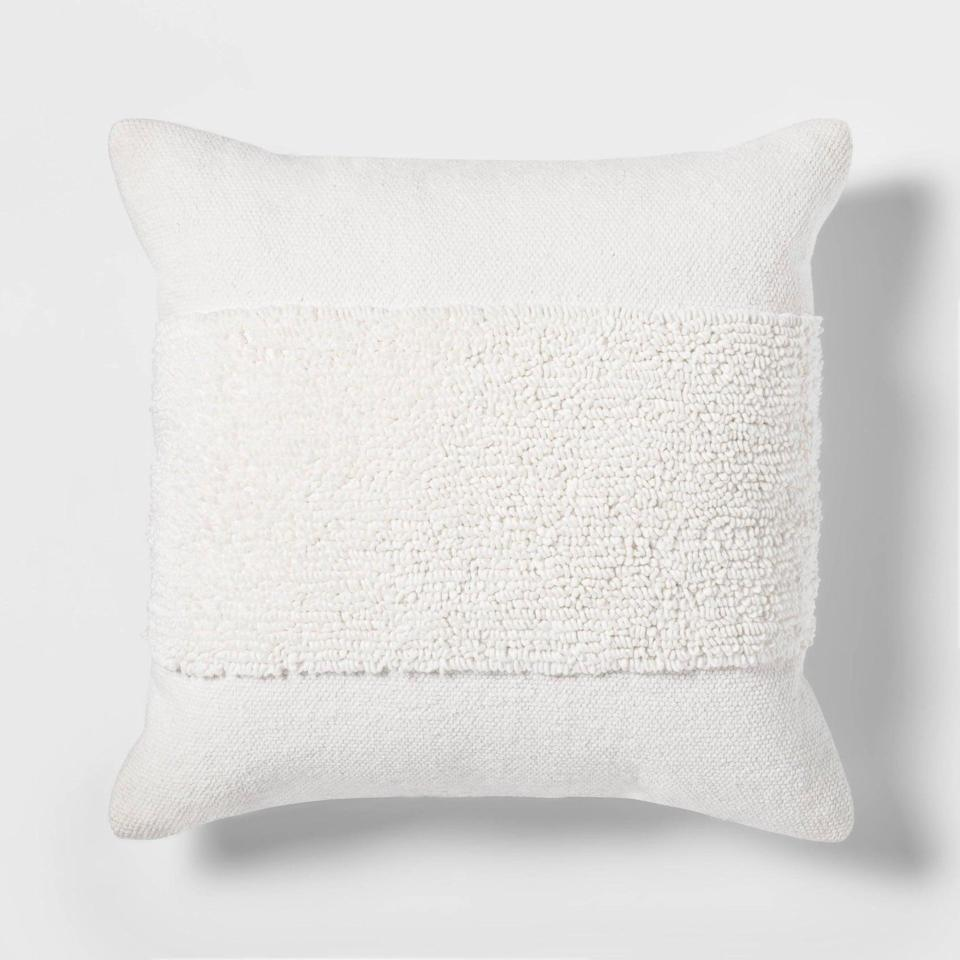 """<p>For a little texture, I got this <a href=""""https://www.popsugar.com/buy/Project-62-Tufted-Modern-Pattern-Square-Throw-Pillow-575414?p_name=Project%2062%20Tufted%20Modern%20Pattern%20Square%20Throw%20Pillow&retailer=target.com&pid=575414&price=20&evar1=casa%3Aus&evar9=47486578&evar98=https%3A%2F%2Fwww.popsugar.com%2Fphoto-gallery%2F47486578%2Fimage%2F47486775%2FProject-62-Tufted-Modern-Pattern-Square-Throw-Pillow&list1=shopping%2Cfurniture%2Ceditors%20pick%2Capartments%2Chome%20decorating%2Csmall%20space%20living%2Capartment%20living%2Cdecor%20shopping%2Chome%20shopping%2Cat%20home%20with%20popsugar&prop13=api&pdata=1"""" class=""""link rapid-noclick-resp"""" rel=""""nofollow noopener"""" target=""""_blank"""" data-ylk=""""slk:Project 62 Tufted Modern Pattern Square Throw Pillow"""">Project 62 Tufted Modern Pattern Square Throw Pillow</a> ($20) - it actually looks quite expensive in person.</p>"""
