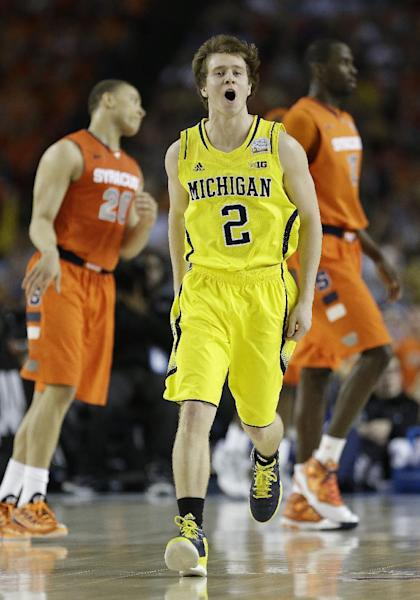 Michigan's Spike Albrecht (2) reacts to play against Syracuse during the first half of the NCAA Final Four tournament college basketball semifinal game Saturday, April 6, 2013, in Atlanta. (AP Photo/Charlie Neibergall)
