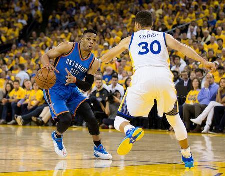 Oklahoma City Thunder Russell Westbrook dribbles as Golden State Warriors Stephen Curry defends in game five. Kelley L Cox-USA TODAY Sports