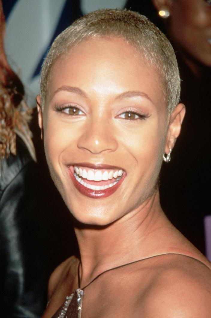 """<h3>Jada Pinkett Smith, 1998</h3><br>Long before buzzcuts were <a href=""""https://www.refinery29.com/en-us/2019/12/8978304/pink-shaved-hair-buzz-cut-instagram"""" rel=""""nofollow noopener"""" target=""""_blank"""" data-ylk=""""slk:the trend"""" class=""""link rapid-noclick-resp"""">the trend</a> they are today, Jada Pinkett Smith hit the 1998 carpet confidently showing off her bold crop.<span class=""""copyright"""">Photo: Mitchell Gerber/Corbis/VCG/Getty Images.</span>"""