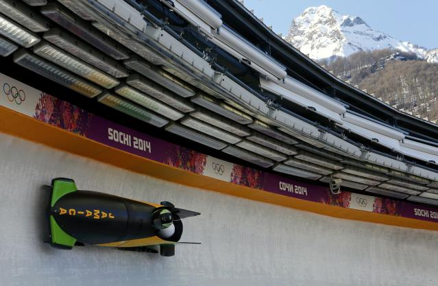 Jamaica's pilot Winston Watts (front) speeds down the track during a two-man bobsleigh training session at the Sanki Sliding Center in Rosa Khutor, a venue for the 2014 Sochi Winter Olympics near Sochi, February 14, 2014. REUTERS/Arnd Wiegmann (RUSSIA - Tags: SPORT BOBSLEIGH OLYMPICS)