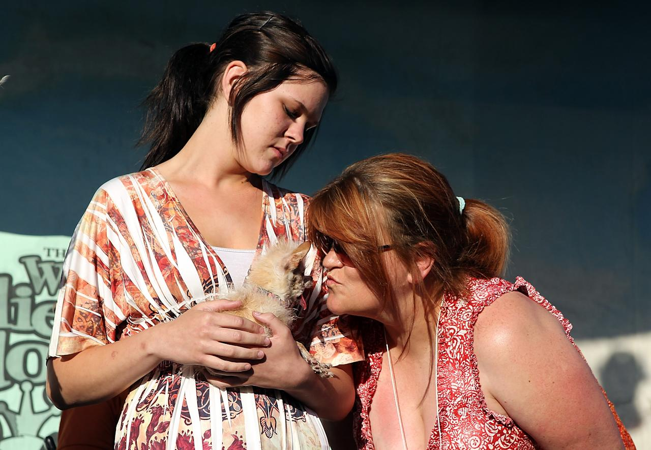 PETALUMA, CA - JUNE 24:  Terry Schumacher (R) and her daughter Nicole of Hanford, California hold their dog Yoda after winning the 23rd Annual World's Ugliest Dog Contest at the Sonoma-Marin County Fair on June 24, 2011 in Petaluma, California.  Yoda won the $1,000 top prize as the world's ugliest dog.  (Photo by Justin Sullivan/Getty Images)