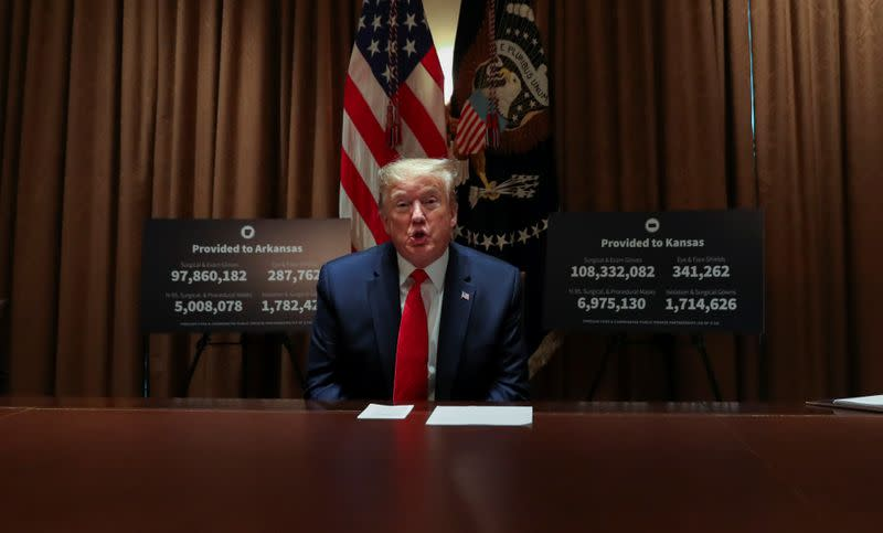 U.S. President Trump holds coronavirus response meeting with Governors Hutchison and Kelly at the White House in Washington