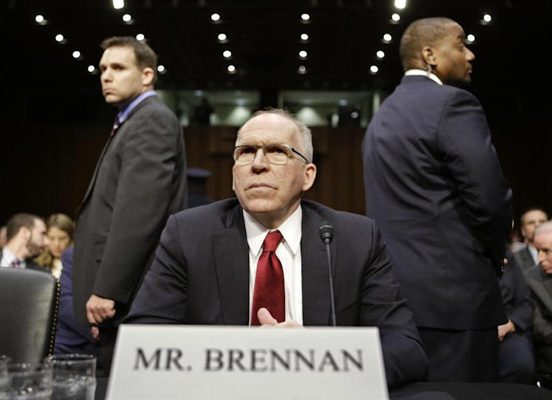 CIA Director nominee John Brennan, flanked by security, arrives on Capitol Hill in Washington, Thursday, Feb. 7, 2013, to testify at his confirmation hearing before the Senate Intelligence Committee. (AP Photo/J. Scott Applewhite)