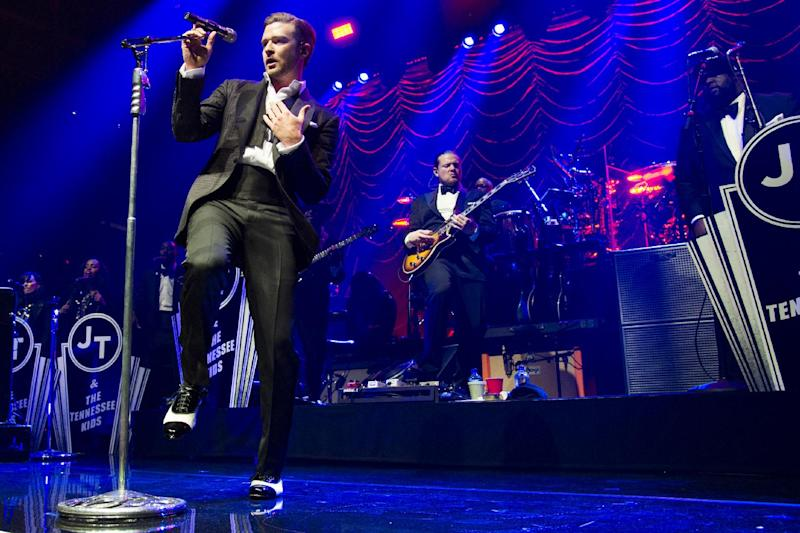 FILE - This May 5, 2013 file photo shows Justin Timberlake performing at the MasterCard Priceless Premieres concert in New York. It's a crowded tour market and everyone is competing for your entertainment dollar. Timberlake and Jay-Z are playing at some of America's most beloved ballparks and offer some of the hottest material going in music. (Photo by Charles Sykes/Invision/AP)
