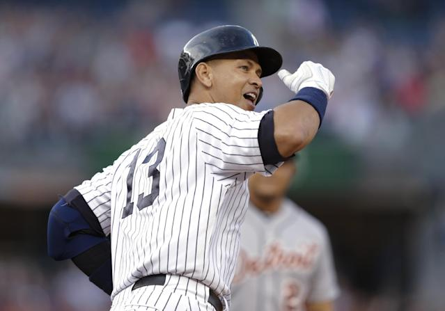 New York Yankees' Alex Rodriguez gestures to the crowd after hitting a home run for his 3,000th career hit, during the first inning of a baseball game against the Detroit Tigers on Friday, June 19, 2015, in New York. (AP Photo/Frank Franklin II)