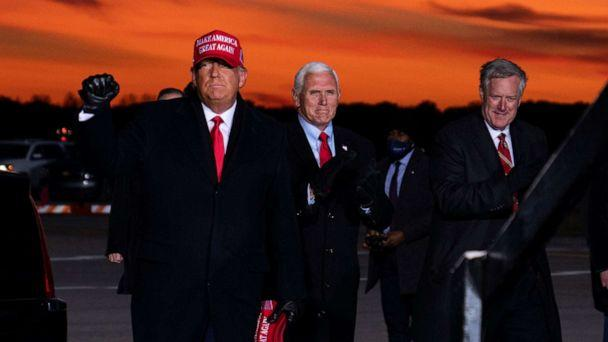 PHOTO: White House chief of staff Mark Meadows accompanies President Donald Trump and Vice President Mike Pence as they arrive for a campaign rally at Cherry Capital Airport, Nov. 2, 2020, in Traverse City, Mich. (Evan Vucci/AP, FILE)