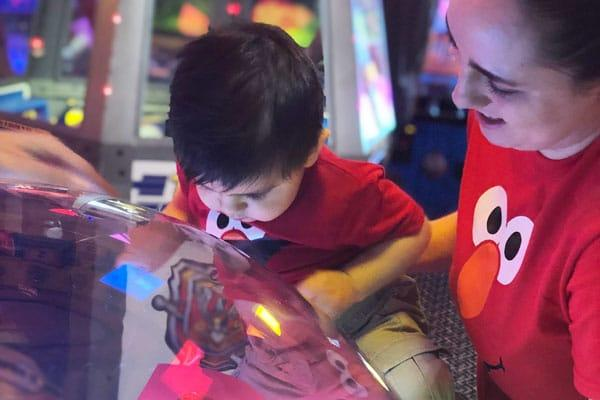Will This Generation's Kids Get the Same Attention From Us?: mother and son playing game in arcade