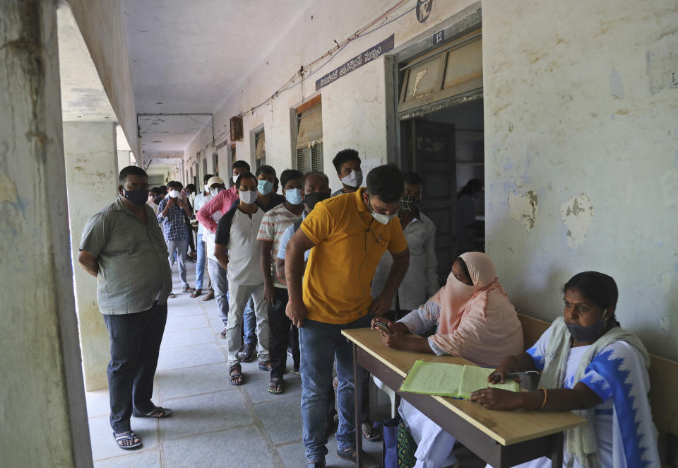 People enroll their names to be administered the Covaxin COVID-19 vaccine during a special vaccination drive at Shadnagar, about 45 kilometers from Hyderabad, India, Thursday, June 17, 2021. (AP Photo/Mahesh Kumar A.)