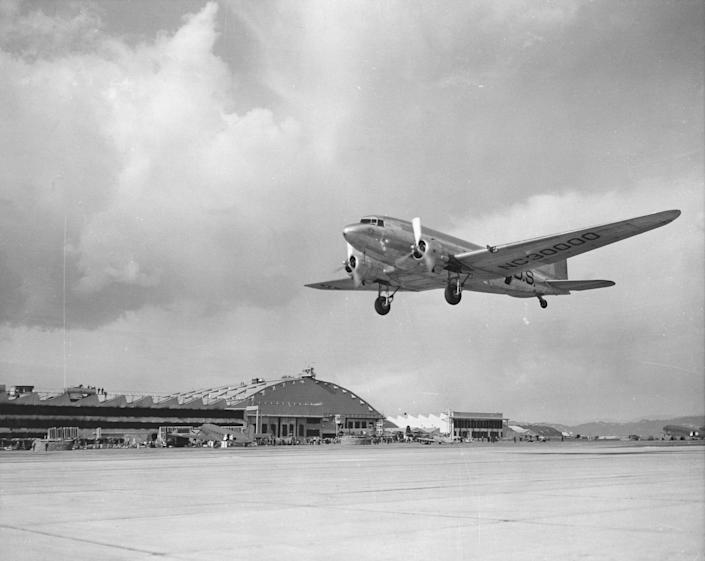 A low angle view of a Douglas DC-3 landing, similar to one that vanished over the Bermuda Triangle in 1948.