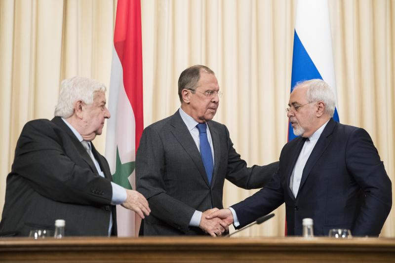 Russian Foreign Minister Sergey Lavrov, center, Iranian Foreign Minister Mohammad Javad Zarif, right, and Syrian Foreign Minister Walid Muallem, left, greet each other after a shared press conference following their talks focused on Syria in Moscow, Russia, Friday, April 14, 2017. (AP Photo/Pavel Golovkin)