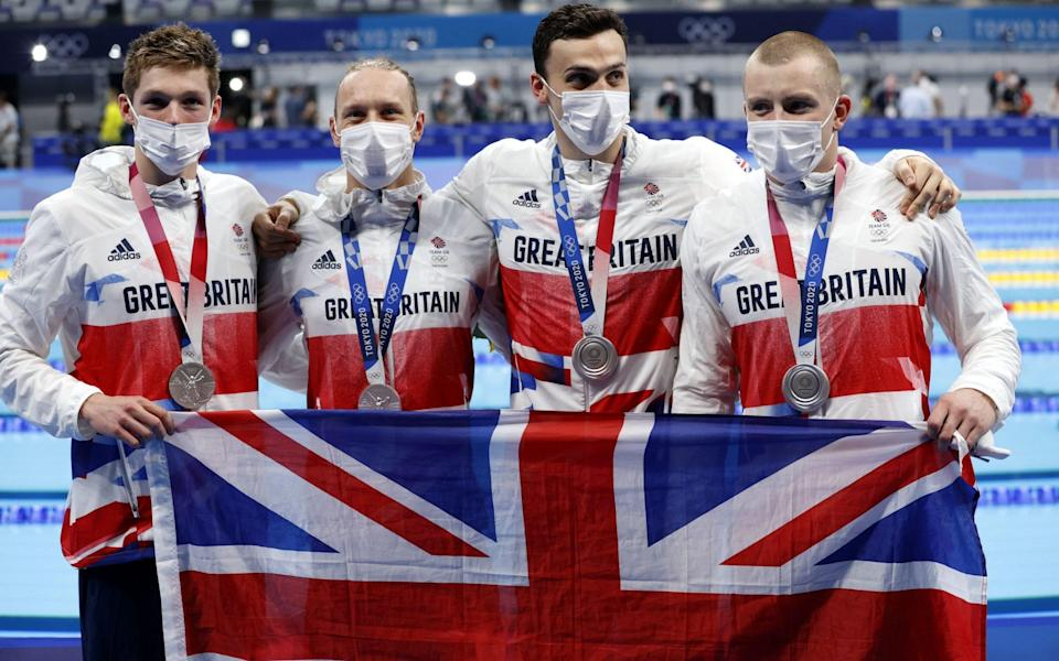 Great Britain's Luke Greenbank, Adam Peaty, James Guy and Duncan Scott celebrate with their gold medals after the Men's 4 x 100m Medley Relay Final during the Swimming events of the Tokyo 2020 Olympic Games at the Tokyo Aquatics Centre in Tokyo, Japan, 01 August 2021. Olympic Games 2020 Swimming,