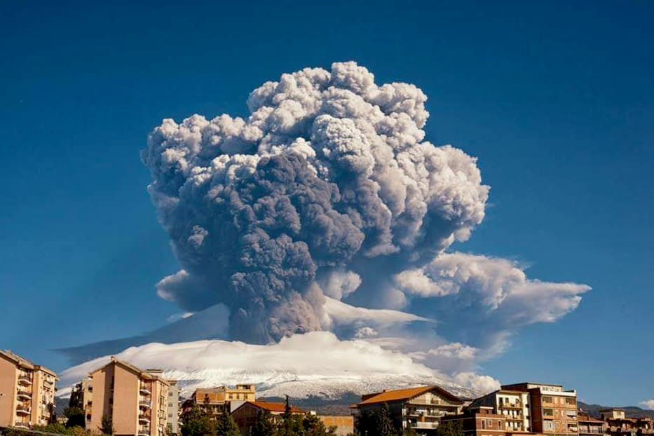 Smoke billows from Mount Etna, Europe's most active volcano, Tuesday, Feb. 16, 2021. Mount Etna in Sicily, southern Italy,  has roared back into spectacular volcanic action, sending up plumes of ash and spewing lava. (Davide Anastasi/LaPresse via AP)