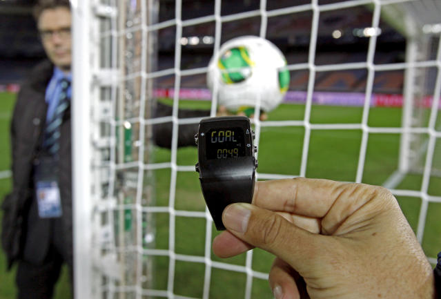 FILE - In this Wednesday, Dec. 5, 2012, file photo, the goal-line monitoring device is demonstrated before the media at Yokohama Stadium in Yokohama, near Tokyo. For the first time at a World Cup, technology will be used to determine whether a ball crosses the goal line during matches at the upcoming tournament in Brazil. With vanishing spray also being used to prevent encroachment by defenders making up a wall during free kicks, officials at the highest level of the world's most popular sport are finally getting some assistance. (AP Photo/Shuji Kajiyama, File)