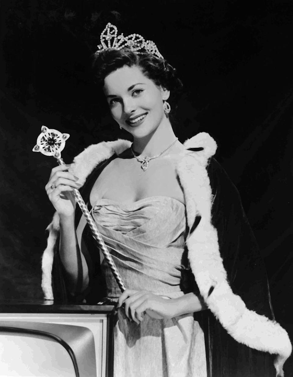 <p>Lee Meriwether from California wore a regal evening gown to match her crown for her Miss America portrait. The pleated detailing and sweetheart neckline brought the perfect amount of glamour to the competition.</p>