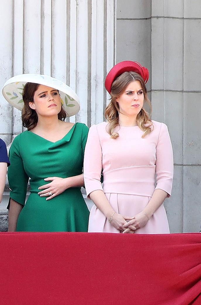 Princess Eugenie chose a green asymmetric Osman dress with a striking Bee Smith 'Leaf Brim' hat, while her older sister Princess Beatrice complemented her in a pale pink dress from The Fold with a red Sally Ann Povran 'Lala' pillbox hat. (PA Images)