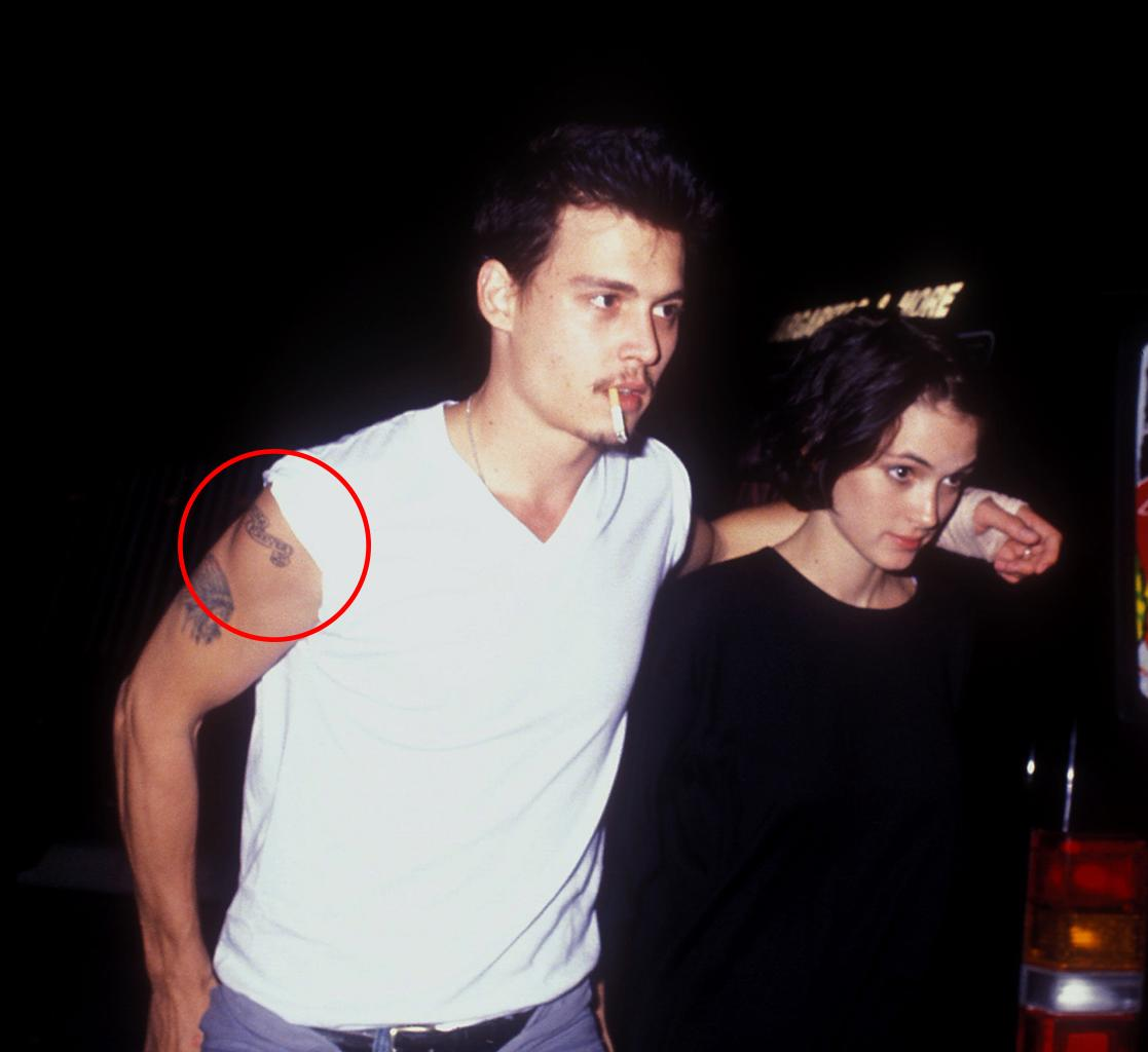 Johnny Depp flashes his tattoo for Winona Ryder. (Photo: Barry King/WireImage)