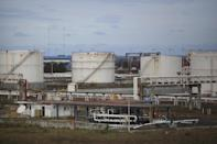 Fuel storage tanks sit at a dispatch terminal of Petroleos Mexicanos (Pemex), Mexico's state-owned oil company, in the port of Veracruz, Mexico, Dec. 30, 2016, days before the 2017 price deregulation goes into effect. Pemex executive Carlos Murriet said in recent days that the country currently has six days' worth in storage. (AP Photo/Felix Marquez)
