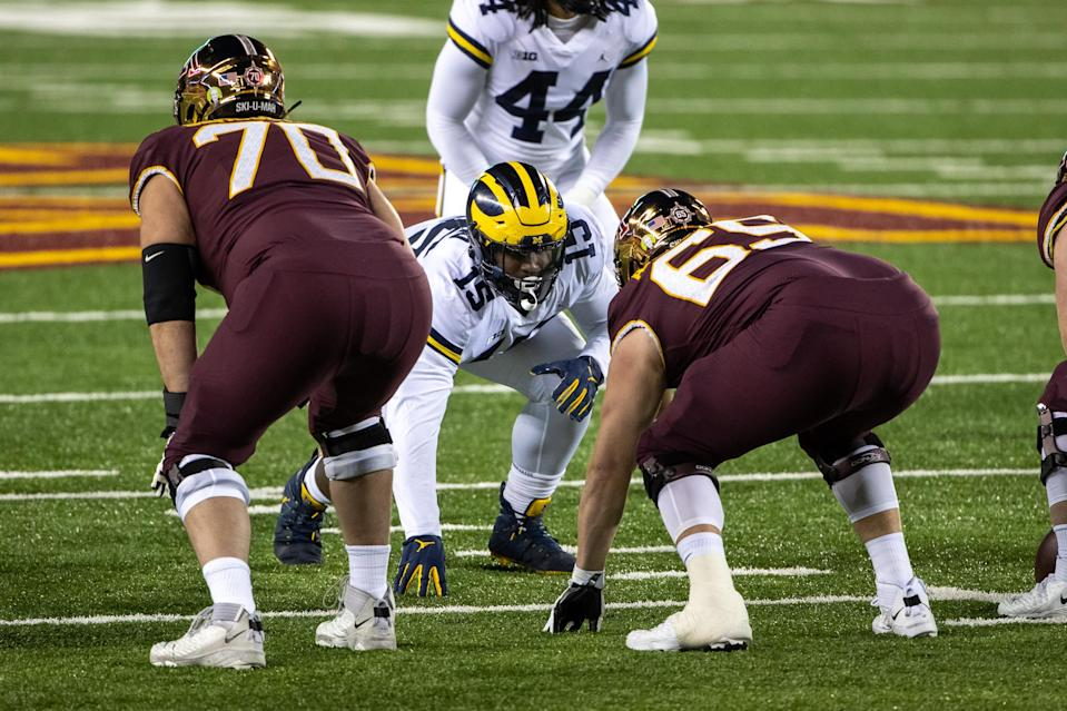 Michigan defensive lineman Christopher Hinton (15) gets ready at the line of scrimmage before a play in the first quarter against Minnesota at TCF Bank Stadium, Oct. 24, 2020.