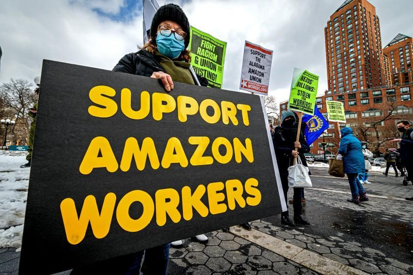 MANHATTAN, NEW YORK, UNITED STATES - 2021/02/20: Participant seen holding a sign at the protest. Members of the Workers Assembly Against Racism gathered across from Jeff Bezos-owned Whole Foods Market in Union Square South for a nation-wide solidarity event with the unionizing Amazon workers in Bessemer, Alabama. (Photo by Erik McGregor/LightRocket via Getty Images)