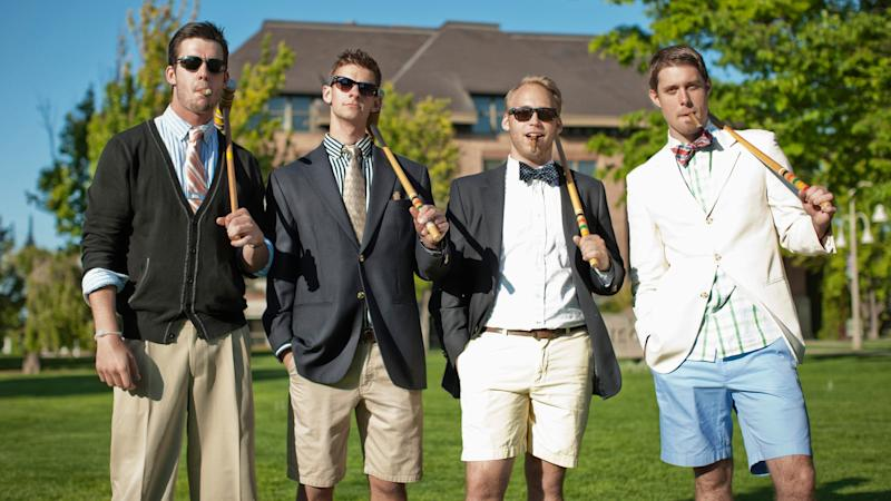 Caucasian men standing together with croquet mallets.